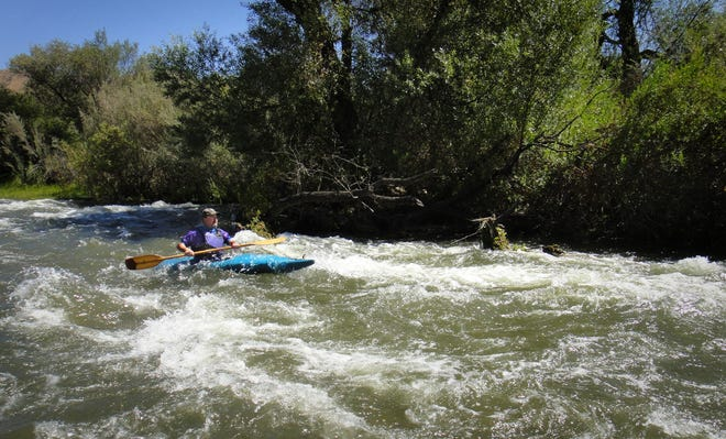 In this 2011 photo, Kenny Ritzi kayaks Piru Creek after a water release from Lake Piru created some rapids in the waterway.