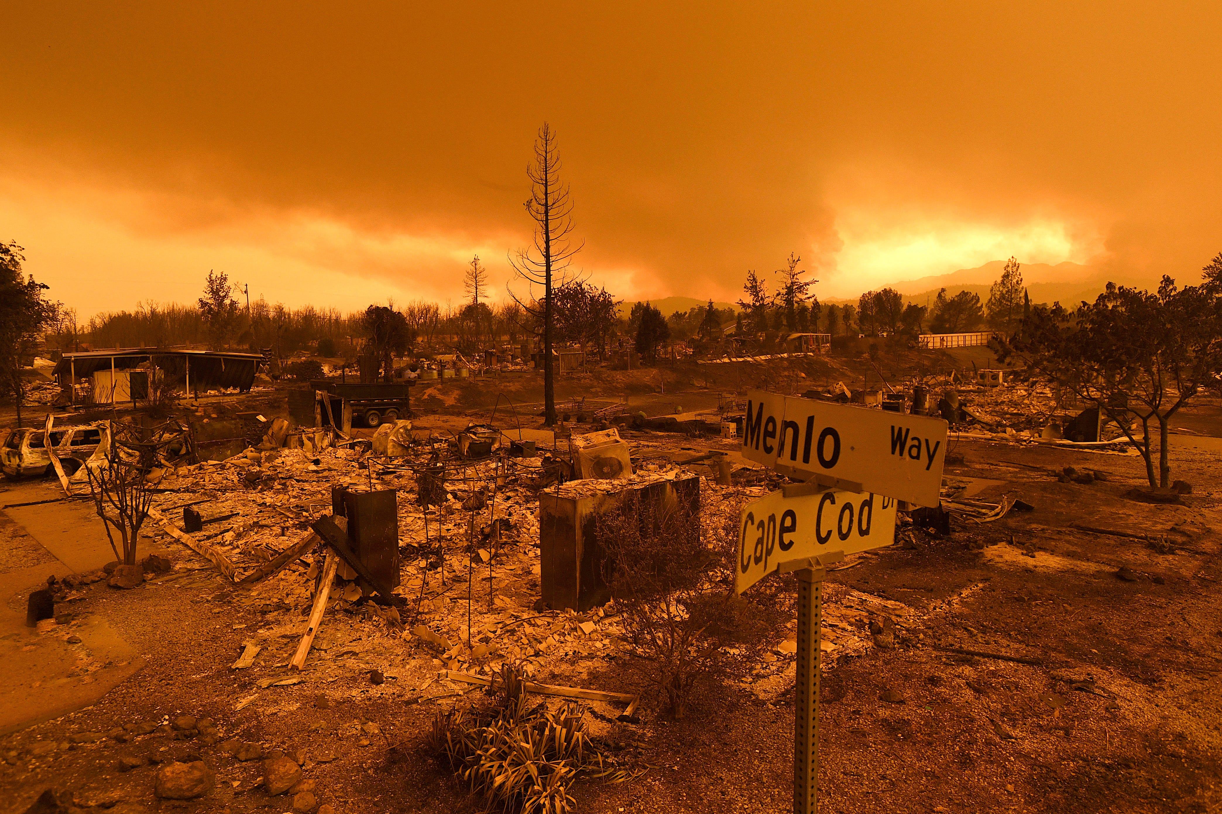 In this July 27 photo, homes leveled by the Carr Fire line the Lake Keswick Estates area of Redding. California lawmakers are abandoning a controversial proposal by Gov. Jerry Brown to shield electrical utilities from some financial liability for wildfires.