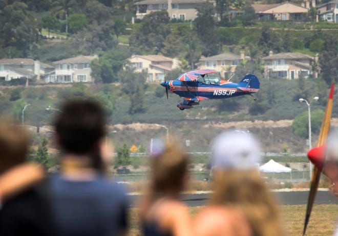 Judy Phelps, in her Pitts airplane, buzzes the runway during the Wings Over Camarillo Air Show at the 2018 show. She will return Aug. 17 and 18 at the Camarillo Airport.