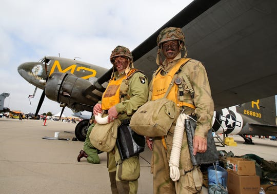 Paratroopers Mike Payton,  left, and Jon Tehan, who are part of the WWII Airborne Demonstration Team, stand next to the C-53D nicknamed D-Day Doll. The team parachuted over the crowd at the Wings Over Camarillo Air Show on Saturday.