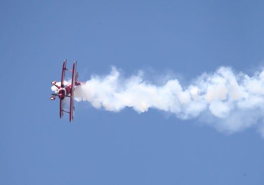 Stunt flier Sammy Mason pulls his plane sideways during the Wings Over Camarillo Air Show in Camarillo on Saturday.