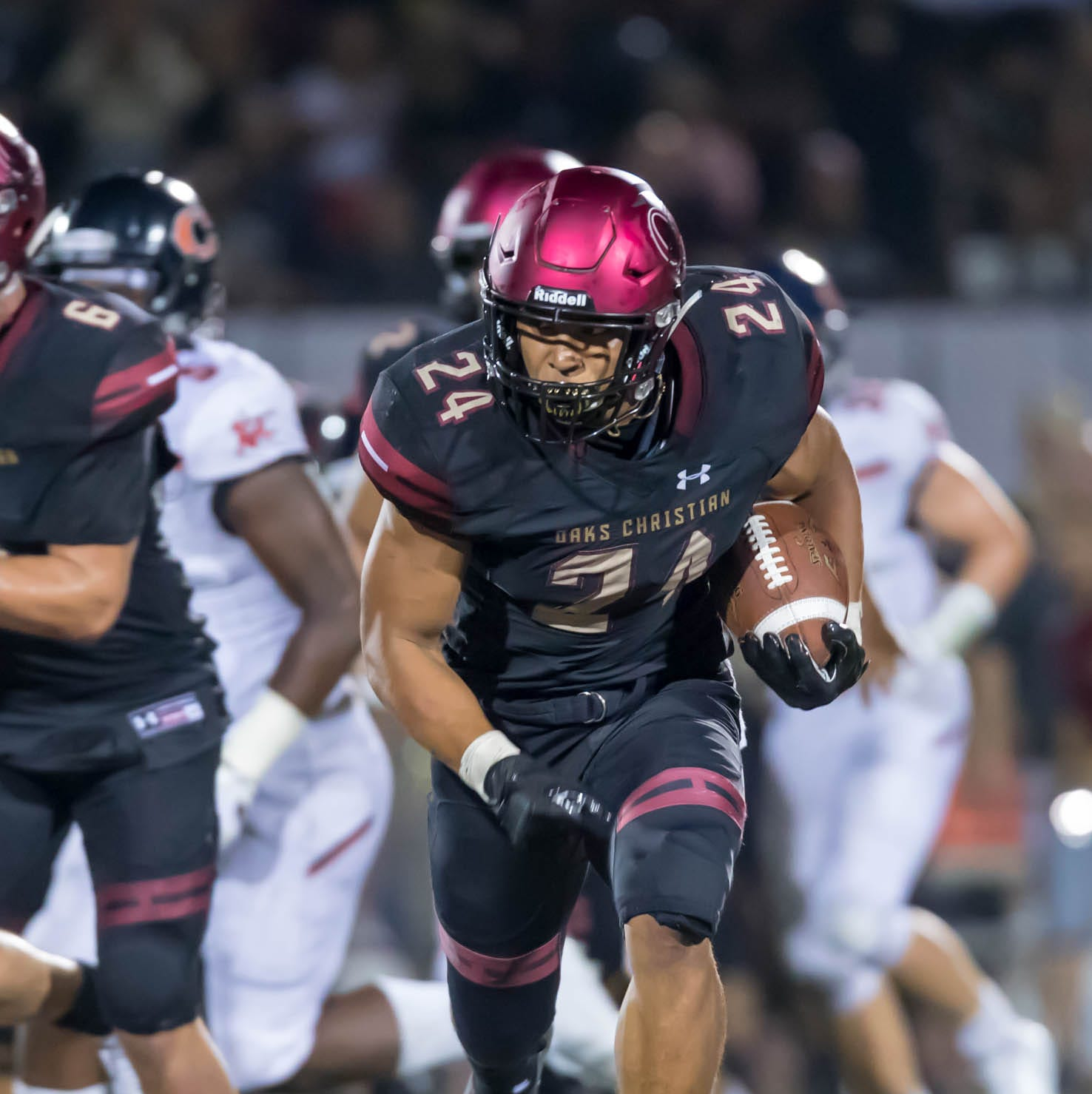 Oaks Christian's Zach Charbonnet is off an running against Chaminade in Thursday's season opener. Charbonnet rushed for 186 yards and three touchdowns in the Lions' 31-13 win.