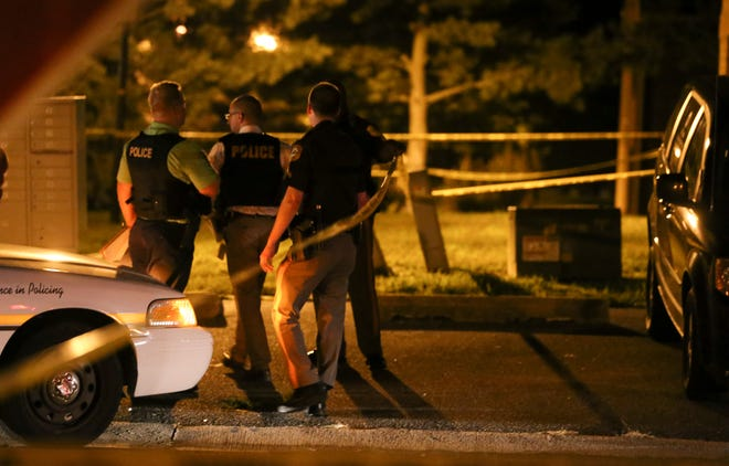 New Castle County Police investigate after a shooting at Revelle and Deen Streets in Wilton Friday night.