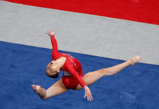 Morgan Hurd competes on the floor exercise at the U.S. Gymnastics Championships, Friday, Aug. 17, 2018, in Boston.