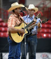 Kevin and Zane Davis of the Bonds Ranch perform during the Music and Skit competition Saturday at the Texas Ranch Roundup at the Kay Yeager Coliseum.