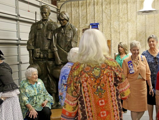 """Members of the Major Francis Grice Chapter National Society Daughters of the American Revolution get their first look at the Vietnam Memorial sculpture titled """"For Those We Shall Never Forget"""" by Garland Weeks Saturday, Aug. 18, 2018, after their first meeting of the season. The sculpture is made of bronze and will be installed in the Veterans Plaza area of the Lake Wichita project."""