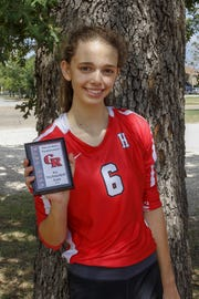 Holliday's Brea Box poses with her all-tournament plaque earned from the Glen Rose Tournament.
