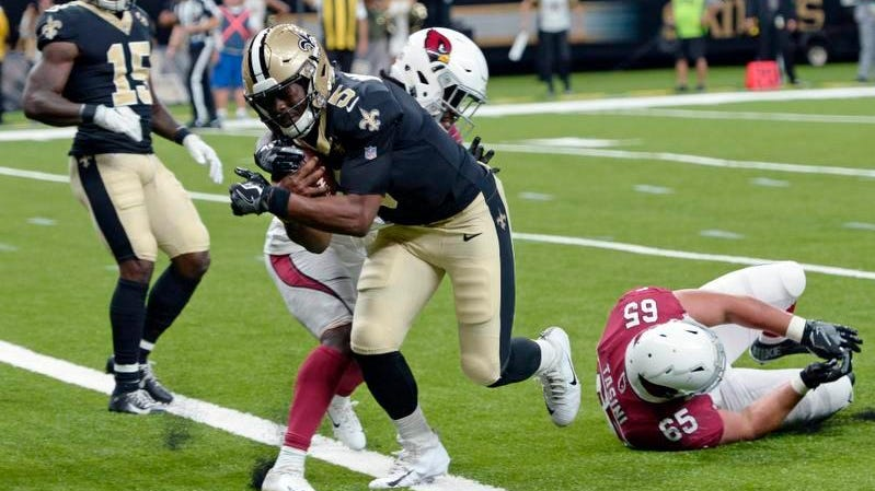 Saints quarterback J.T. Barrett  rushes for a touchdown in Friday's exhibition loss to Arizona.