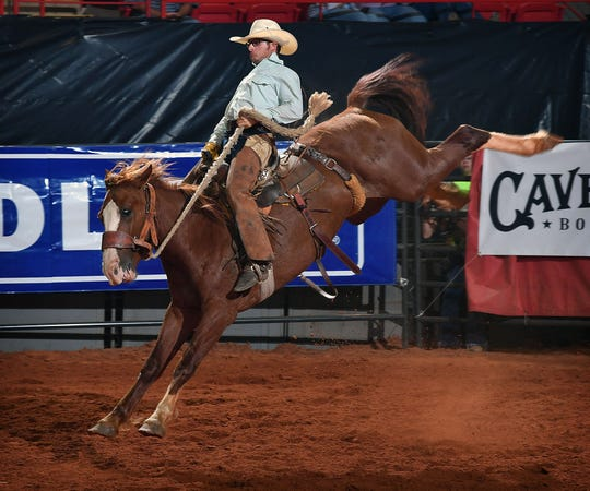 Riding for the Burns Ranch, Colten Mayo earned a score of 76 on a bronc named Centerfold Friday night at the Texas Ranch Roundup at the Kay Yeager Coliseum.