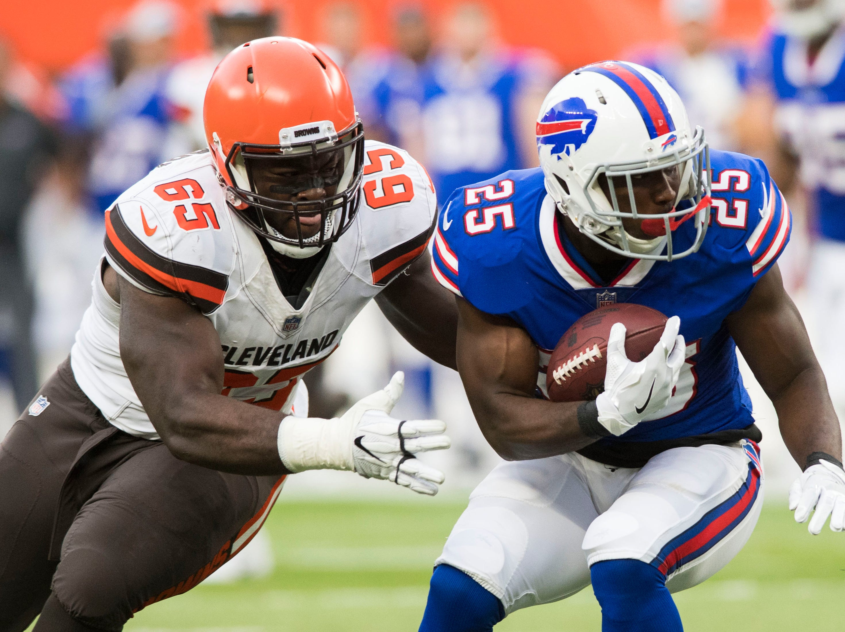 Cleveland Browns defensive tackle Larry Ogunjobi (65) tackles Buffalo Bills running back LeSean McCoy (25) during the first quarter at FirstEnergy Stadium.