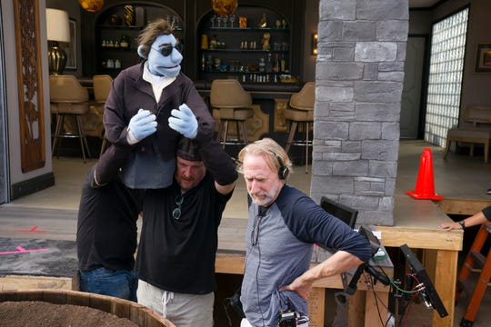 "Puppeteer Bill Barretta handles Phil, the detective star of the R-rated ""The Happytime Murders,"" next to director Brian Henson on the set."