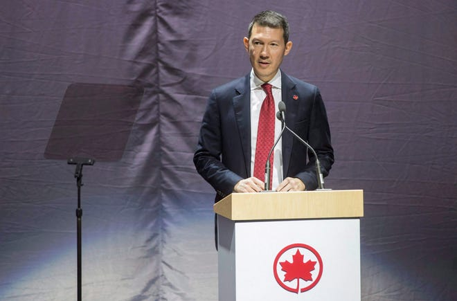 In this Feb. 9, 2017, Air Canada president Benjamin Smith, speaks before revealing the new Air Canada Boeing 787-8 Dreamliner at a hangar at the Toronto Pearson International Airport.