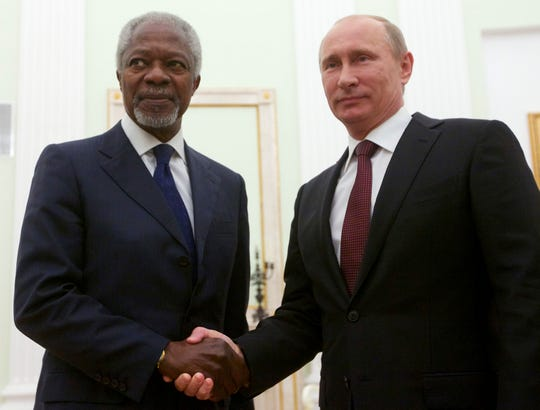 Russian President Vladimir Putin, right, shakes hands with United Nations special envoy Kofi Annan in Moscow, Russia, July 17, 2012.