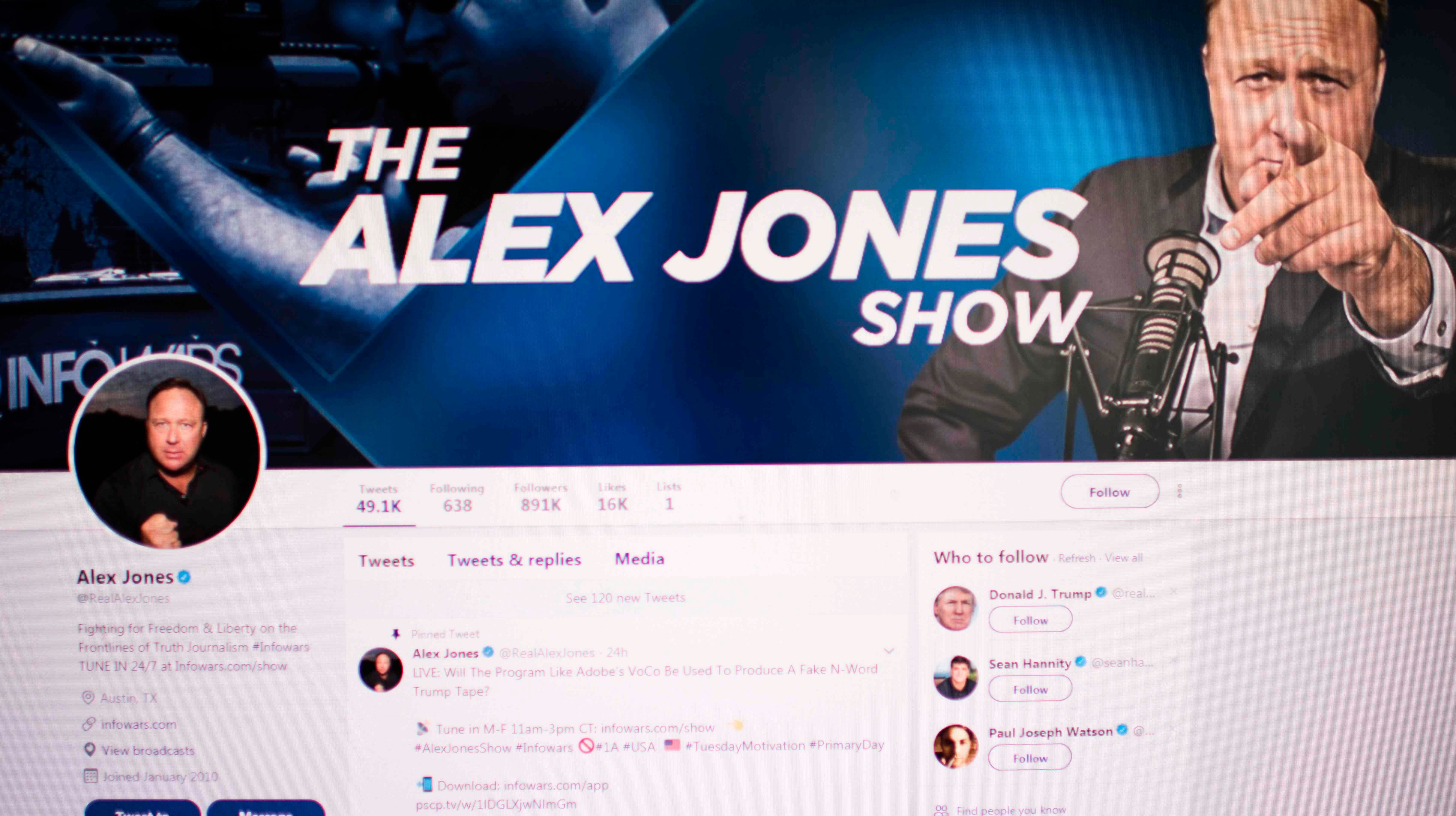 Picture showing a computer screen displaying the Twitter account of Far-right conspiracy theorist Alex Jones taken on August 15, 2018 in Washington DC.