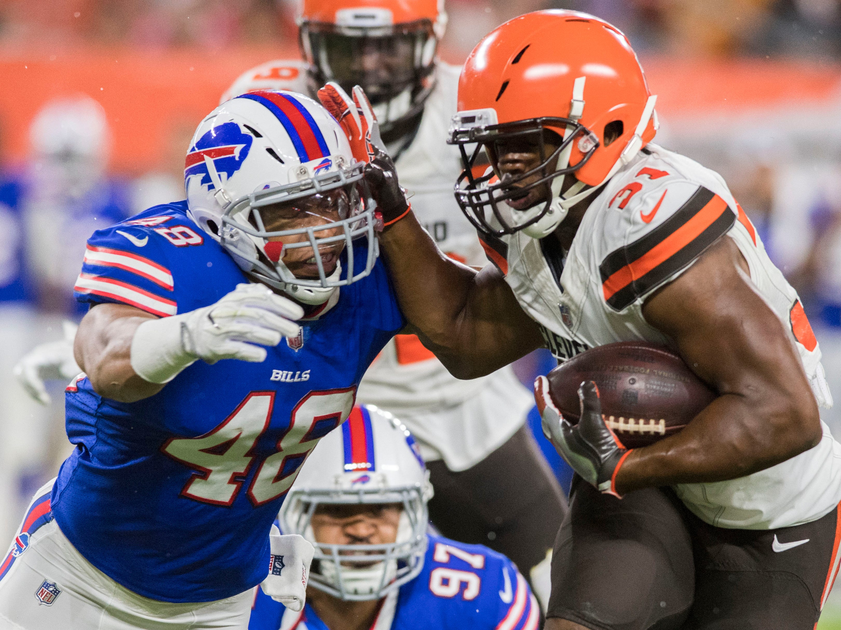 Cleveland Browns running back Nick Chubb (31) runs with the ball against Buffalo Bills linebacker Keenan Robinson (48) during the second half at FirstEnergy Stadium.