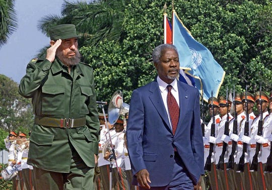 Cuban President Fidel Castro, left, and General Secretary of the United Nations  Kofi Annan review a guard of honor upon Annan's arrival in Havana, April 11, 2000.
