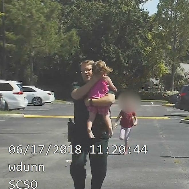 'Didn't feel a pulse': Dramatic video shows Florida deputy saving girl trapped in hot car