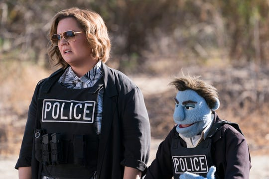 "Melissa McCarthy trades barbs with a puppet in ""The Happytime Murders."""
