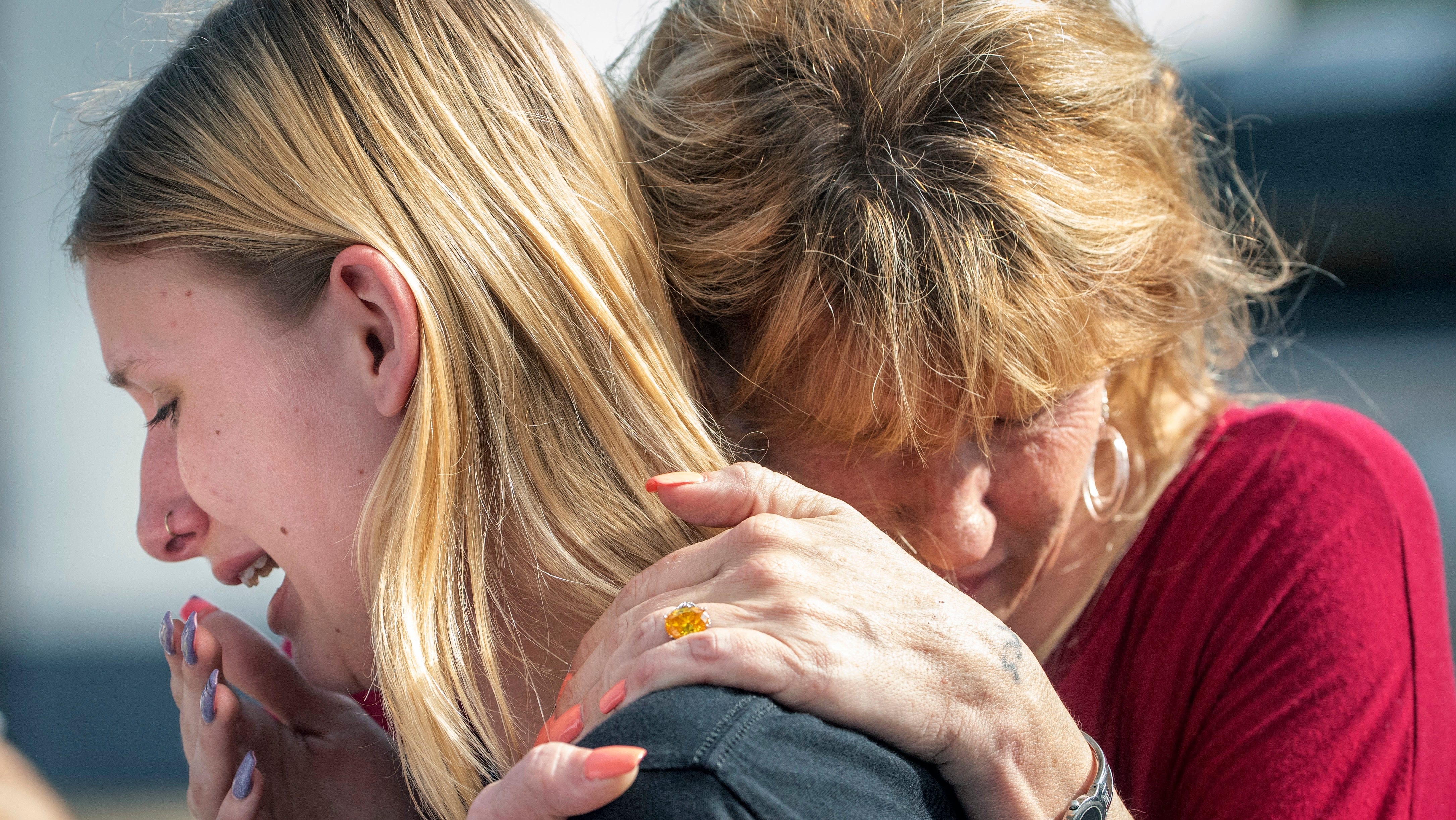 In this May 18, 2018 file photo, Santa Fe High School student Dakota Shrader is comforted by her mother Susan Davidson following a shooting at the school in Santa Fe, Texas.