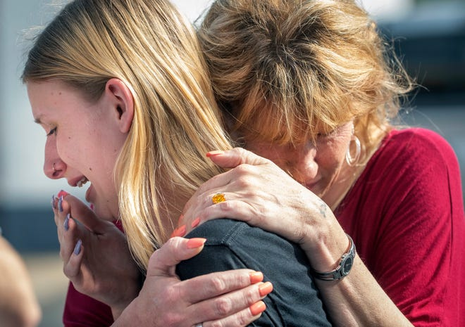 Santa Fe High School student Dakota Shrader is comforted by her mother, Susan Davidson, May 18, 2018, after a shooting at the school.