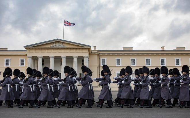 Troops forming an Honor guard march at the Royal Sandhurst Military Academy Sandhurst (RMAS) on January 18, 2018.