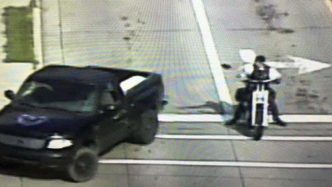 Appleton police released four photos, including this one of a pickup truck driver and motorcyclist, in connection with their investigation into a drive-by shooting Saturday at the intersection of West Prospect Avenue and South Memorial Drive.