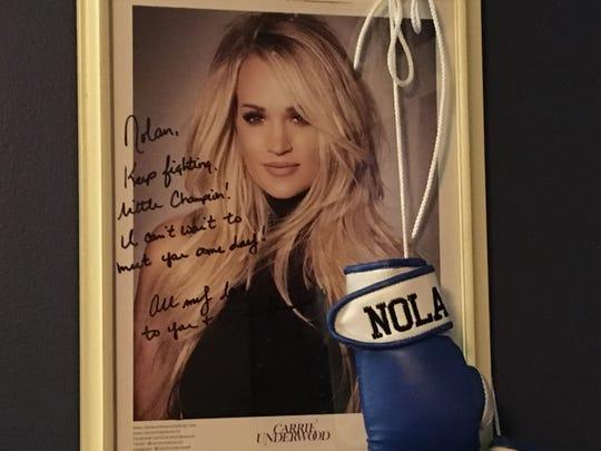 Singer Carrie Underwood sent this message of encouragement to Nolan. It hangs on his bedroom wall.