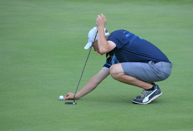 Kory Roberts lines up a putt on No. 18 during his final round of the Calhoun County Amateur Golf Championship.