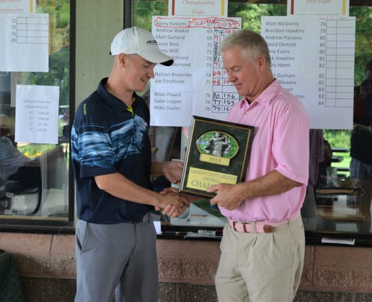 Kory Roberts is congratulated by Ron Osborne after winning the 41st annual Calhoun County Amateur Golf Championship.