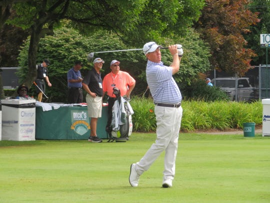 Glen Day tees off at hole No. 1 at En-Joie Golf Course on Sunday.