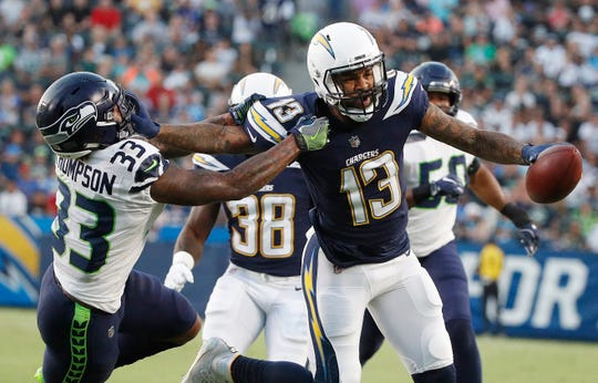 Los Angeles Chargers wide receiver Keenan Allen (13) stiff-arms Seattle Seahawks defensive back Tedric Thompson (33).