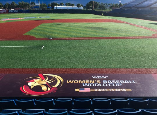 The banner on the dugout is in place at the main stadium for the Women's Baseball World Cup at the USSSA Sports Complex in Viera.