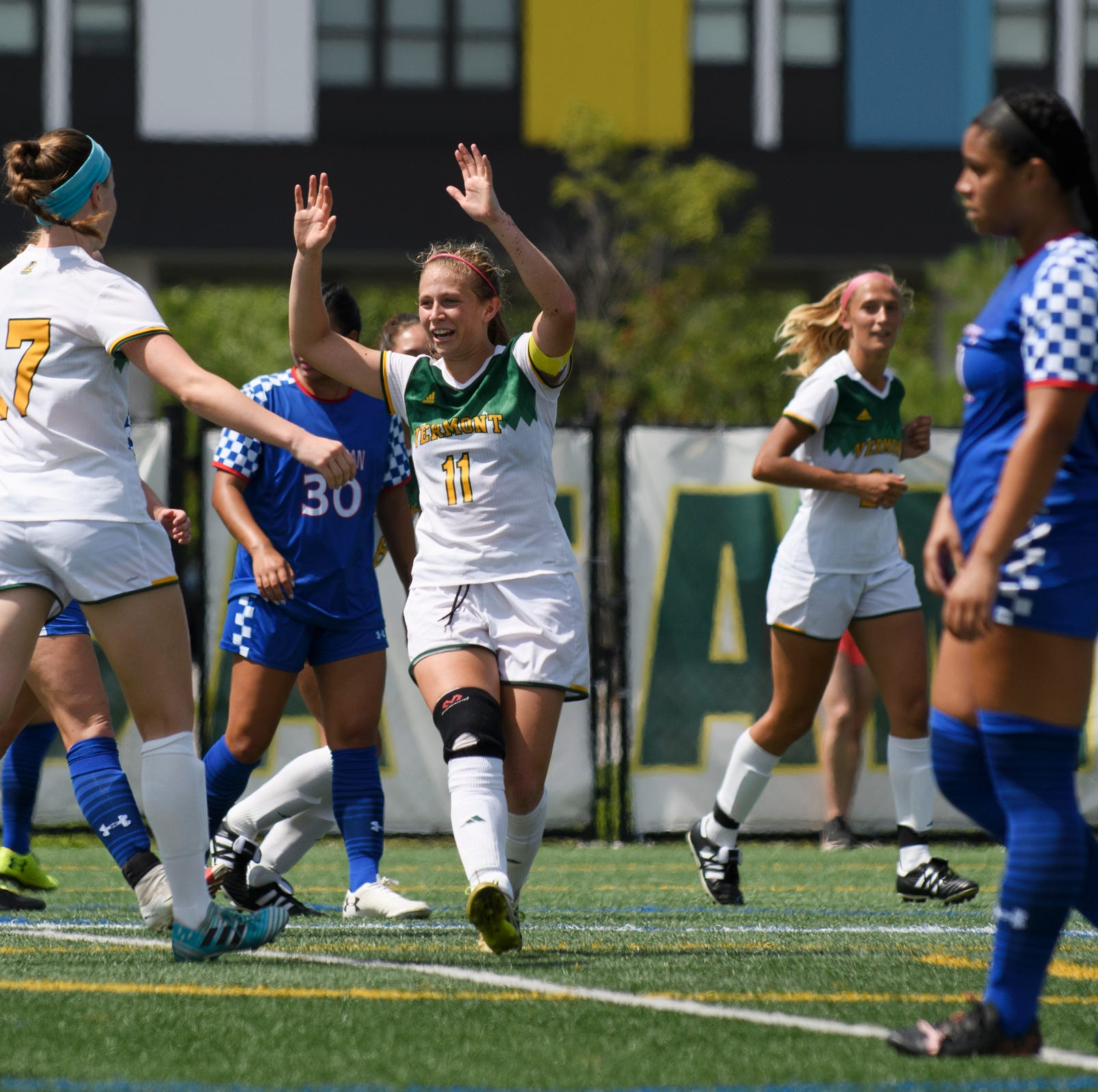 Vermont's Brooke Jenkins (11) celebrates a goal with Aly Spencer (17) during the women's soccer game between the American Eagles and the Vermont Catamounts at Virtue Field on Sunday afternoon August 19, 2018 in Burlington.