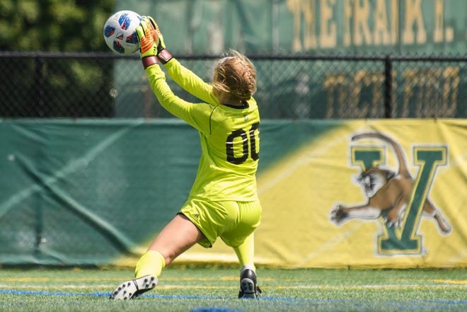Vermont goalie Kacey Lambertson (00) makes a save during the women's soccer game between the American Eagles and the Vermont Catamounts at Virtue Field on Sunday afternoon August 19, 2018 in Burlington.