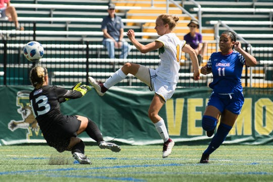 Vermont's Ella Bankert (10) tries to kick the ball past American goalie Ryleigh Brown (13) during the women's soccer game between the American Eagles and the Vermont Catamounts at Virtue Field on Sunday afternoon August 19, 2018 in Burlington.