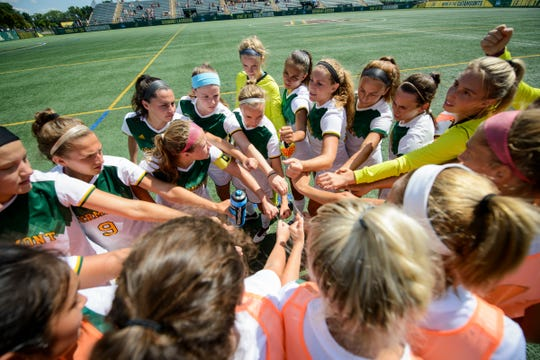 Vermont huddles together during the women's soccer game between the American Eagles and the Vermont Catamounts at Virtue Field on Sunday afternoon August 19, 2018 in Burlington.