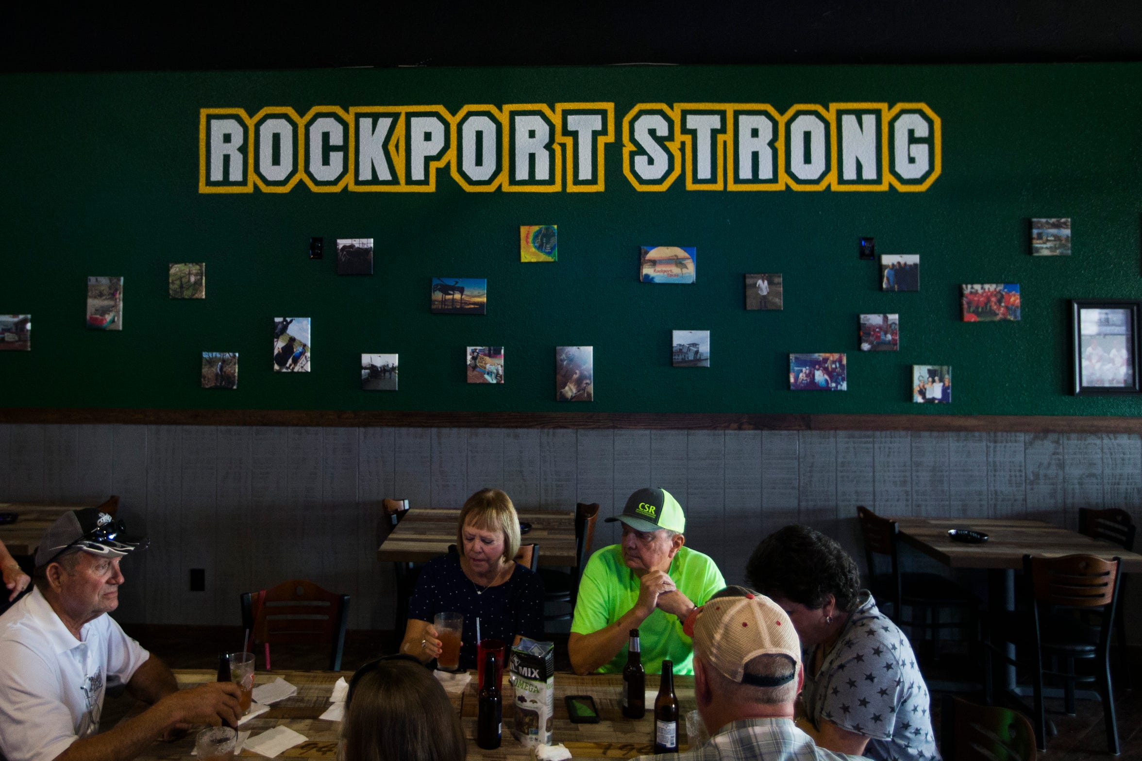 People enjoy drinks at the Rockbottom bar in Rockport, Texas.
