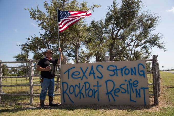 Carlos Casas stands in front of his sign on Sunday, August, 19, 2018  outside his home in Rockport. He made it after Hurricane Harvey made landfall there and it's stood as a message of hope for many residents.