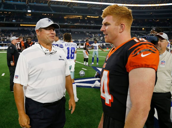 Former Bengals coach Paul Alexander and Cincinnati Bengals quarterback Andy Dalton (14) catch up on the field after the fourth quarter of the NFL Preseason Week Two game between the Dallas Cowboys and the Cincinnati Bengals at AT&T Stadium in Arlington, Texas, on Saturday, Aug. 18, 2018. The Bengals took a 21-13 win over the Cowboys,