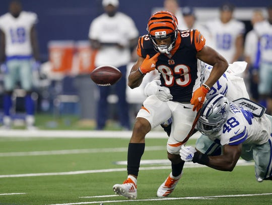 Cincinnati Bengals wide receiver Tyler Boyd (83) fumbles the ball after a catch in the second quarter of the NFL Preseason Week Two game between the Dallas Cowboys and the Cincinnati Bengals at AT&T Stadium in Arlington, Texas, on Saturday, Aug. 18, 2018.
