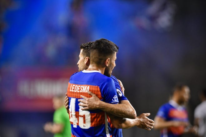 FC Cincinnati's Emmanuel Ledesma and Nazmi Albadawi celebrate a third goal against Charleston Saturday, August 18th at Nippert Stadium