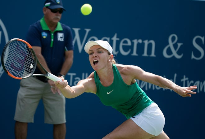 Simona Halep returns to Kiki Bertens during the Western & Southern Open Women's Singles finals match at the Lindner Family Tennis Center in Mason on Sunday.
