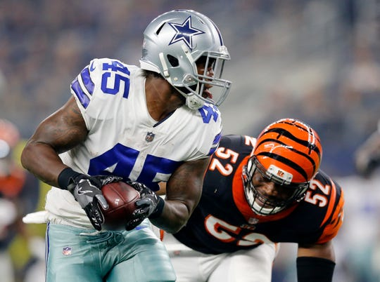 Dallas Cowboys running back Rod Smith (45) runs from Cincinnati Bengals linebacker Preston Brown (52) in the first quarter of the NFL Preseason Week Two game between the Dallas Cowboys and the Cincinnati Bengals at AT&T Stadium in Arlington, Texas, on Saturday, Aug. 18, 2018.