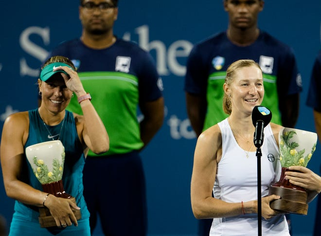 Lucie Hradeck‡ speaks as Ekaterina Makarova looks on after they won the Western & Southern Open Women's Doubles Final against E. Mertens and D. Schuurs at the Lindner Family Tennis Center in Mason, Ohio, on Saturday, Aug. 18, 2018.