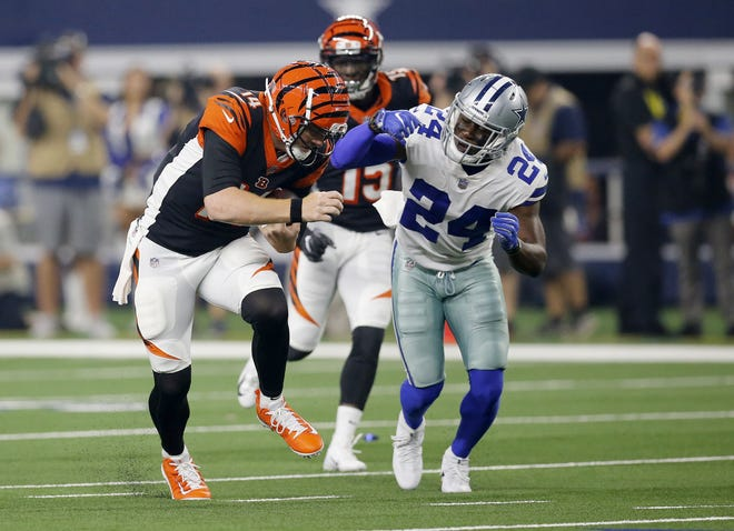 Cincinnati Bengals quarterback Andy Dalton (14) runs for a first down in the second quarter of the NFL Preseason Week Two game between the Dallas Cowboys and the Cincinnati Bengals at AT&T Stadium in Arlington, Texas, on Saturday, Aug. 18, 2018.