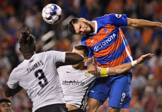 FC Cincinnati defender, Forrest Lasso, battles for a cross in the Charleston box Saturday, August 18th at Nippert Stadium