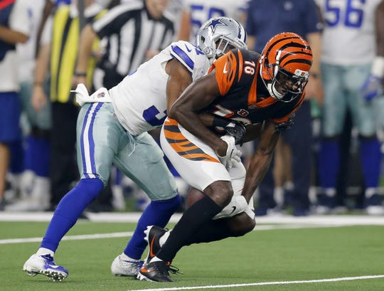 Cincinnati Bengals wide receiver A.J. Green (18) catches a pass between his knees in the second quarter of the NFL Preseason Week Two game between the Dallas Cowboys and the Cincinnati Bengals at AT&T Stadium in Arlington, Texas, on Saturday, Aug. 18, 2018.
