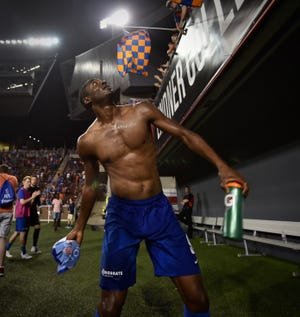 Fanendo Adi launches his game jersey into the stands after FC Cincinnati's 3-0 victory over the Charleston Battery Saturday, August 18th at Nippert Stadium