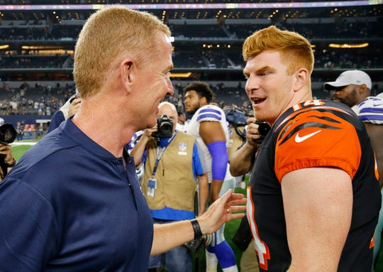Dallas Cowboys head coach Jason Garrett and Cincinnati Bengals quarterback Andy Dalton (14) shake hands after the fourth quarter of the NFL Preseason Week Two game between the Dallas Cowboys and the Cincinnati Bengals at AT&T Stadium in Arlington, Texas, on Saturday, Aug. 18, 2018. The Bengals took a 21-13 win over the Cowboys,