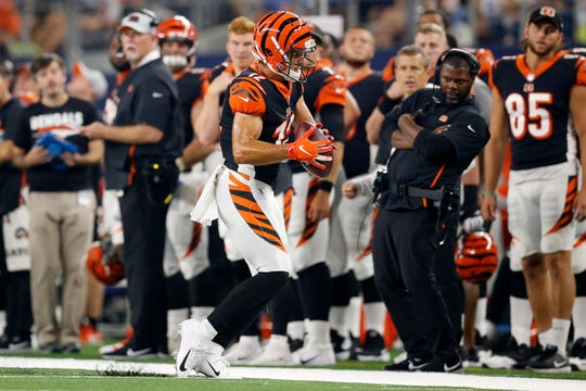 Cincinnati Bengals wide receiver Alex Erickson (12) drags his toes to stay in bounds on a pass in the third quarter of the NFL Preseason Week Two game between the Dallas Cowboys and the Cincinnati Bengals at AT&T Stadium in Arlington, Texas, on Saturday, Aug. 18, 2018. The Bengals took a 21-13 win over the Cowboys,